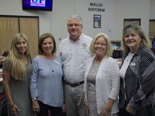 County Commissioner Tom Zorc (center) stands with Amy Patterson, Carmen Stork, Barbara Butts and Linda Rusciano, board members of United Against Poverty Indian River County.