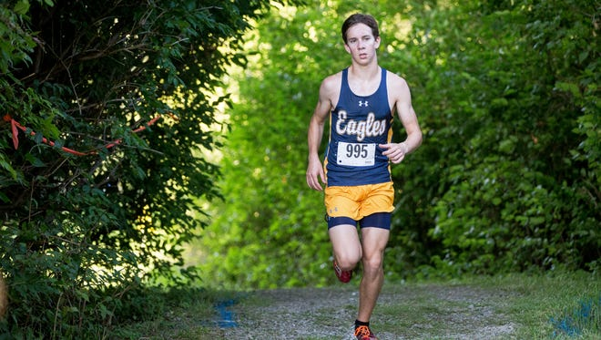 Girls and guys teams take part in the county cross country meet Tuesday evening at Cowan High School.