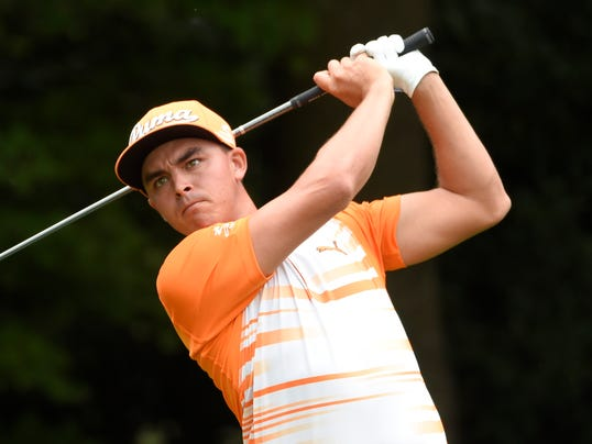 Rickie fowler tees off the third hole during the final round of the