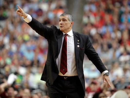 South Carolina head coach Frank Martin directs his team during the second half against Gonzaga in the semifinals of the Final Four NCAA college basketball tournament, Saturday, April 1, 2017, in Glendale, Ariz. (AP Photo/Mark Humphrey)