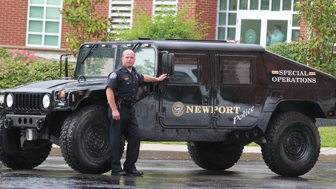 Newport Police Lt. Jerry Ripberger  stands with a Humvee received from the U.S. military. This vehicle is not armor-plated. The department uses the vehicle in inclement winter weather.