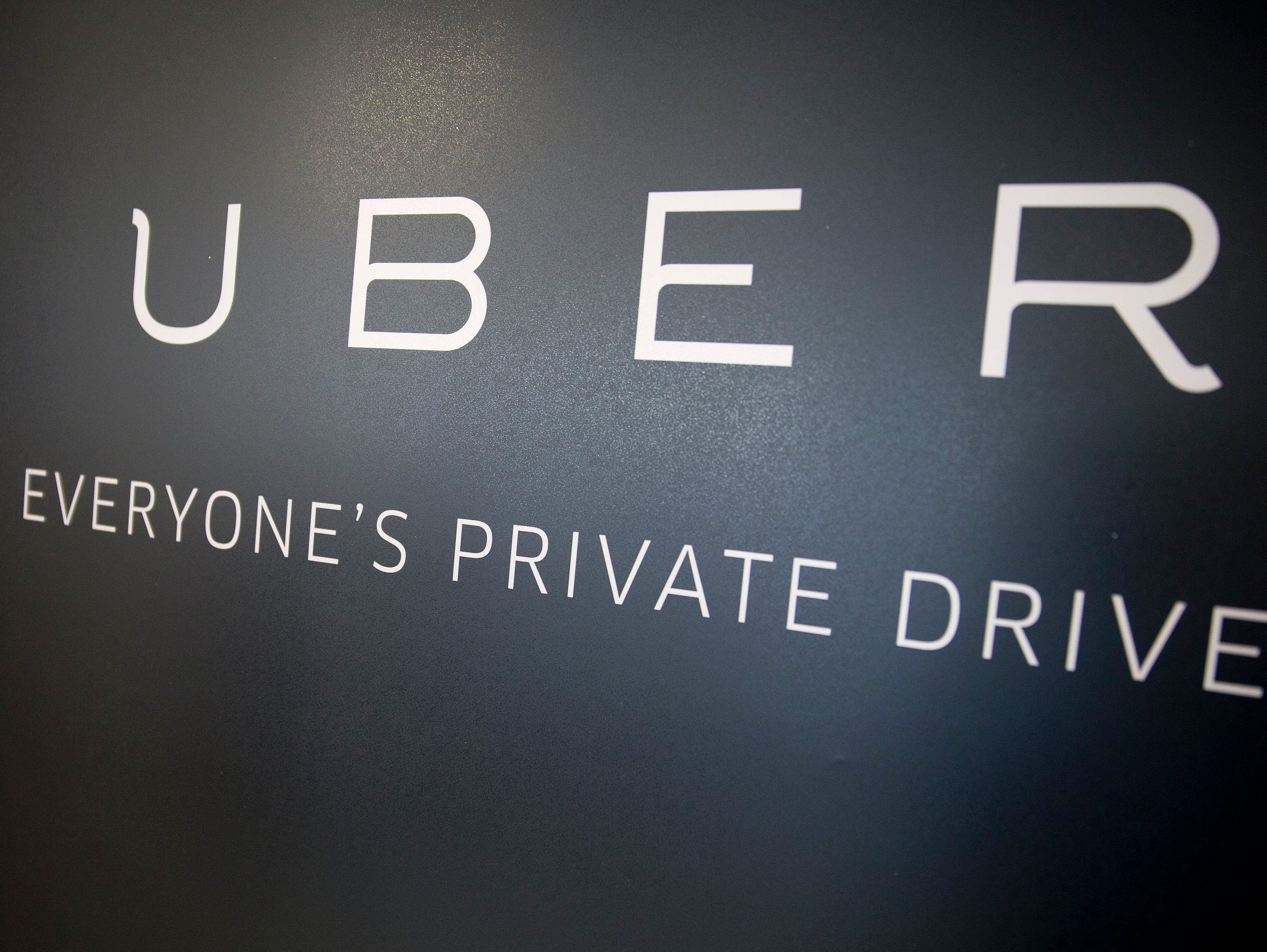 Uber Technologies Inc. signage stands inside the company's office prior to Senator Marco Rubio, a Republican from Florida, speaking in Washington, D.C., U.S., on Monday, March 24, 2014. Rubio addressed the need to adapt antiquated government regulati