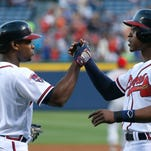 ATLANTA, GA - APRIL 25:  Justin Upton #8 of the Atlanta Braves celebrates his three-run homer against the Cincinnati Reds in the first inning with B.J. Upton #2 at Turner Field on April 25, 2014 in Atlanta, Georgia.  (Photo by Kevin C. Cox/Getty Images)