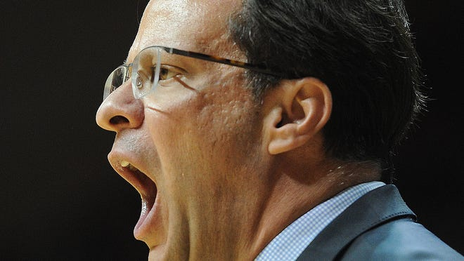 Tom Crean shouts instructions to his IU team during the game. The Indiana University Hoosiers hosted the Ohio State Buckeyes in a Big Ten mens basketball game at Assembly Hall in Bloomington on Sunday March 2, 2014.