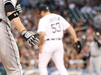 Chicago White Sox Carlos Sanchez greets Tyler Flowers at home plate after Flowers two run home run scored both in the second inning against the Detroit Tigers in Detroit on Monday, September 22, 2014.
