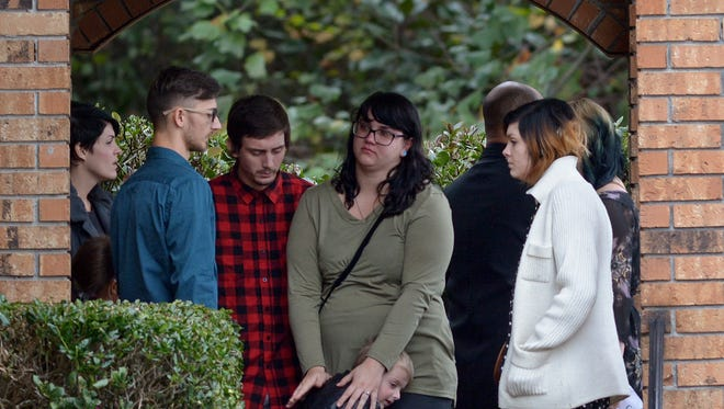 Family and friends speak outside Moore's Funeral Home as they wait for funeral services to begin for 6-year-old Jeremy Mardis in Hattiesburg, Miss. Nov. 9, 2015.   Jeremy Mardis, a 6-year-old autistic boy, was killed and his father wounded when marshals opened fire on their vehicle in Marksville, Louisiana. Authorities have arrested two of the four officers involved in the shooting.
