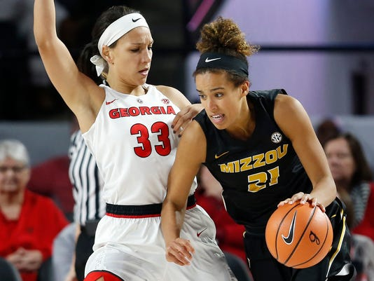 Missouri forward Cierra Porter (21) is defended by Georgia forward Mackenzie Engram (33) during an NCAA college basketball game in Athens, Ga., Thursday, Jan. 25, 2018. (Joshua L. Jones/Athens Banner-Herald via AP)