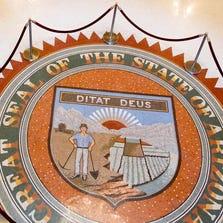 Arizona State Capitol Museum's  rotunda displays a Arizona miner in the state seal.