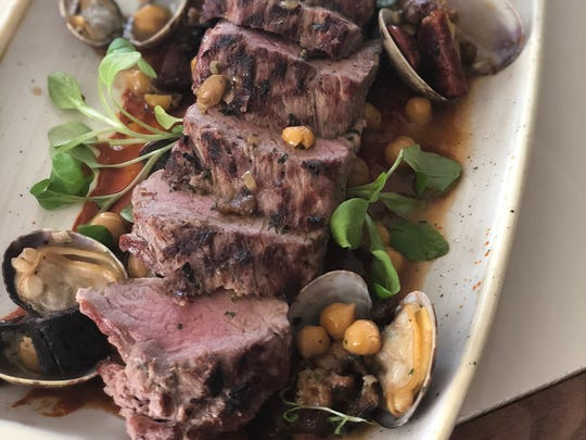 Matt Kerley is fond of the Iberian pork with sauteed clams, spinach, chorizo, garbanzo beans and harissa sauce, served at Hotel Madrid.