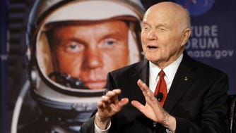 """U.S. Sen. John Glenn talks with astronauts on the International Space Station via satellite before a discussion about """"Learning from the Past to Innovate for the Future"""" in Columbus, Ohio, in 2012."""