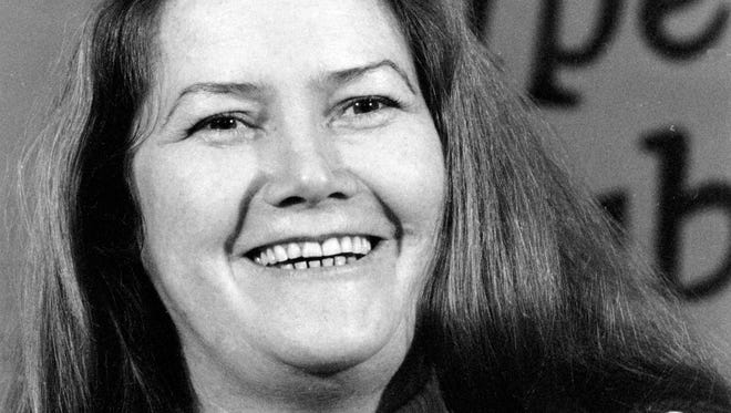 """Australian author Colleen McCullough laughs during a news conference in New York on March 1, 1977. Best-selling author McCullough, whose novel """"The Thorn Birds"""" sold 30 million copies worldwide, has died at age 77 after a long illness. McCullough died Thursday, Jan. 29, 2015 in hospital on remote Norfolk Island, HarperCollins Australia publishing director Shona Martyn said in a statement."""