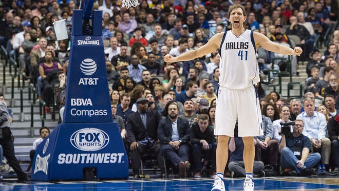 Dallas Mavericks forward Dirk Nowitzki (41) reacts during the second quarter against the Cleveland Cavaliers at the American Airlines Center.