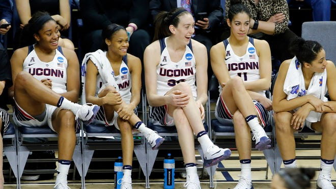 Mar 21, 2016; Storrs, CT, USA; (From left to right) Connecticut Huskies forward Morgan Tuck (3), guard Moriah Jefferson (4), forward Breanna Stewart (30) and guard Kia Nurse (11) cross their legs on the bench as they take on the Duquesne Dukes during the second half in the second round of the 2016 women's NCAA Tournament at Gampel Pavilion. UConn defeated Duquesne 97-51.  Mandatory Credit: David Butler II-USA TODAY Sports