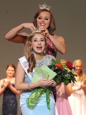 Rosie Westerbeck crowns Emily Krejci as the 2015 Miss Ohio's Outstanding Teen Wednesday evening at the Renaissance Theatre.