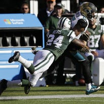 Jaguars wide receiver Allen Robinson (15) makes a catch against Jets cornerback Darrelle Revis (24) on Nov. 8.