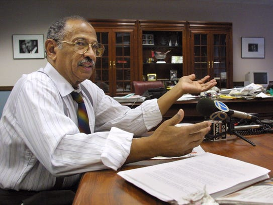 Rep. John Conyers Jr., D-Mich., talks to reporters