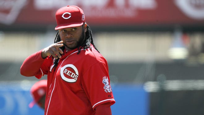Cincinnati Reds starting pitcher Johnny Cueto (47) points to the dugout prior to the game against the St. Louis Cardinals, Saturday.
