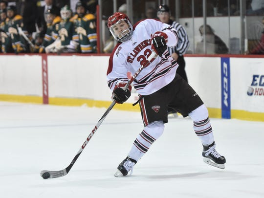 Defenseman Ben Finkelstein, a South Burlington native, unleashes a shot while playing for the St. Lawrence men's hockey team,