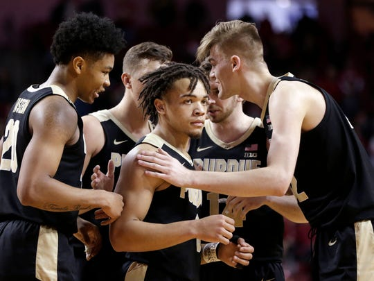 Purdue's Matt Haarms, right, addresses teammates during the second half of an NCAA college basketball game against Nebraska in Lincoln, Neb., Saturday, Feb. 23, 2019. (AP Photo/Nati Harnik)