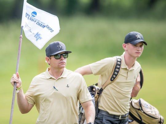 Vanderbilt coach Scott Limbaugh, front
