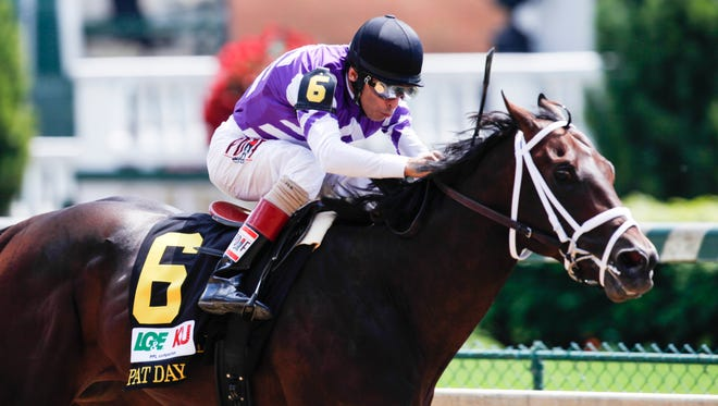 Jockey John Velazquez rides Competitive Edge to an easy win in the 91st Running of the Pat Day Mile on Saturday. May 2, 2015