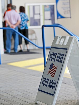Voters wait to cast ballots in the Republican and Democratic primaries at a polling station at the Miami Beach City Hall, Tuesday, March 15, 2016, in Miami Beach, Fla. (AP Photo/Wilfredo Lee)