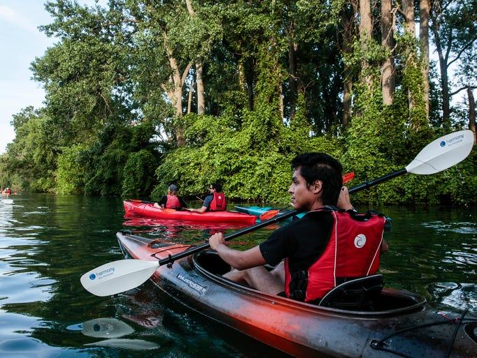 Omar Hyjek of Detroit enjoys the scenery as he paddles