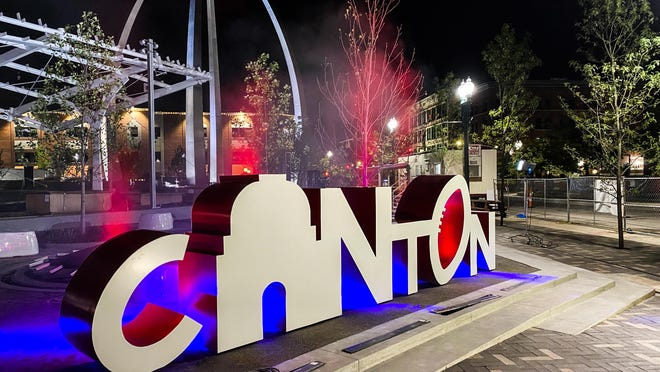 "The ""Canton"" sign at Centennial Plaza lights up as part of the celebration of the National Football League's 100th birthday, which was marked Thursday with the public unveiling of 11 Player Pylons."
