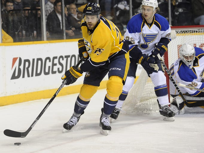 Predators left wing Viktor Stalberg controls the puck against the St. Louis Blues during the first period at Bridgestone Arena on March 6, 2014.