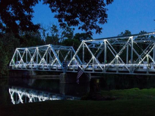 The Finley River bridge in Ozark  is aglow with lights