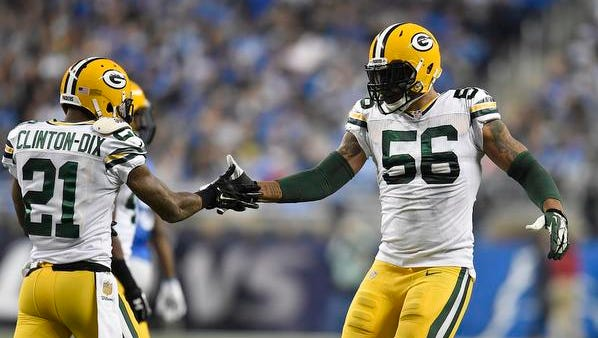 Green Bay Packers teammates Ha Ha Clinton-Dix and Julius Peppers (56) celebrate a defensive play against the Detroit Lions at Ford Field.