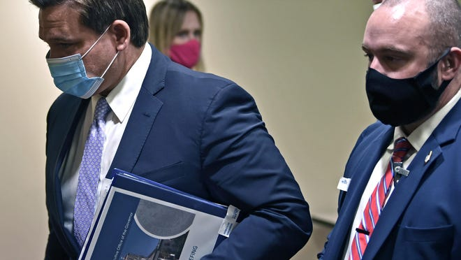 Florida Gov. Ron DeSantis leaves after a COVID-19 press conference at Blake Medical Center in Bradenton Saturday.