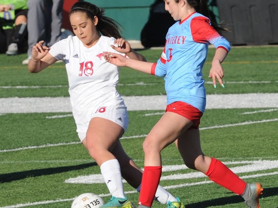 Cooper's Judith Macias, left, battles a Lubbock Monterey player for the ball on March 20 at Shotwell Stadium. On Monday, she signed to play soccer at Sul Ross University.