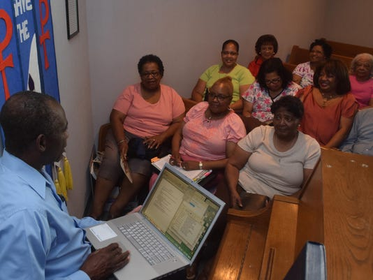 ANI Newman United Methodist Church Pastor Joseph Awotwi (far left) of Newman United Methodist Church conducts a Bible study group Wednesday, June 24, 2015. The church is celebrating its 150th anniversary.-Melinda Martinez/The Town Talk