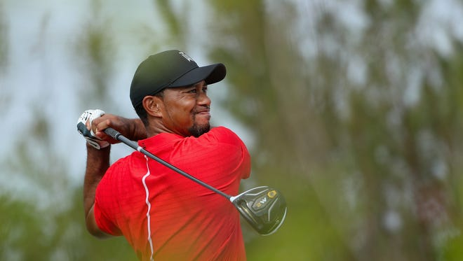 Tiger Woods of the United States hits his tee shot on the 11th hole during the final round of the Hero World Challenge at Albany, The Bahamas on Dec. 4, 2016.