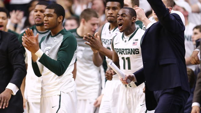 The Michigan State Spartans celebrate during a game against the Penn State Nittany Lions at the Breslin Center on Jan. 21, 2015, in East Lansing.