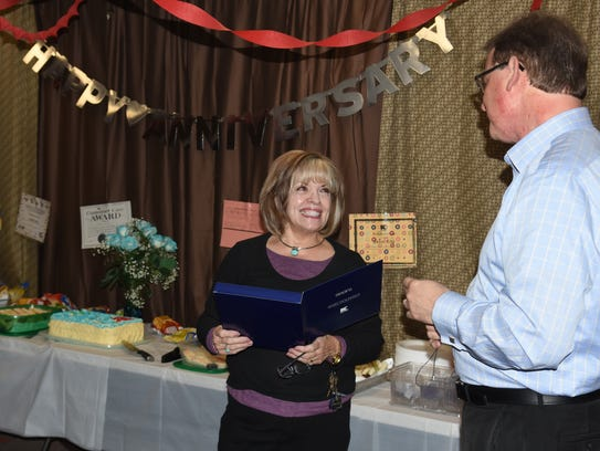 Halls Kmart employee Glenda King smiles at district