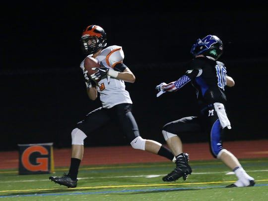 Dover's Griffin Langiu (2) catches a first half touchdown
