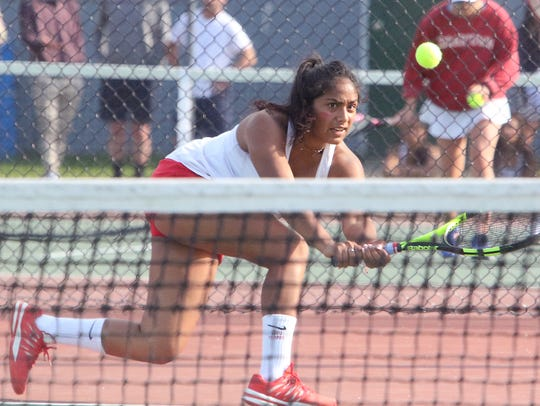 Champlain Valley's Stephanie Joseph reaches to return a backhand in her singles match during the Division I high school girls tennis championship on Thursday in Shelburne.
