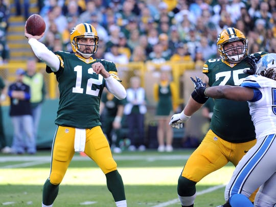 Green Bay Packers quarterback Aaron Rodgers (12) throws against the Detroit Lions at Lambeau FIeld.