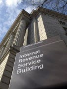 File photo show the Washington, D.C. headquarters of the IRS, which has mounted a continuing battle against offshore tax evasion