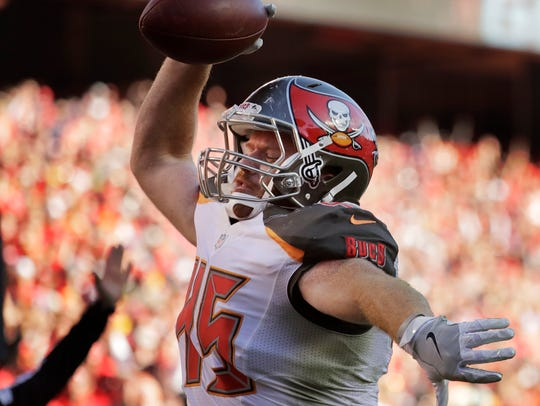 Buccaneers tight end Alan Cross (45) spikes the ball after scoring his first, and only, career touchdown Nov. 20, 2016, against the Chiefs.