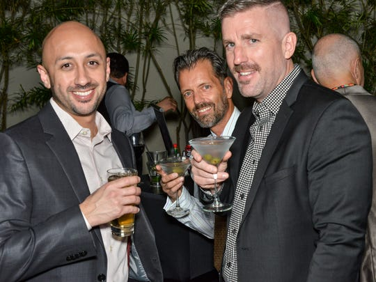 Art Dominguez, James, Meyers, Gregory Hopkins (l-r) enjoying cocktails at Center Stage.