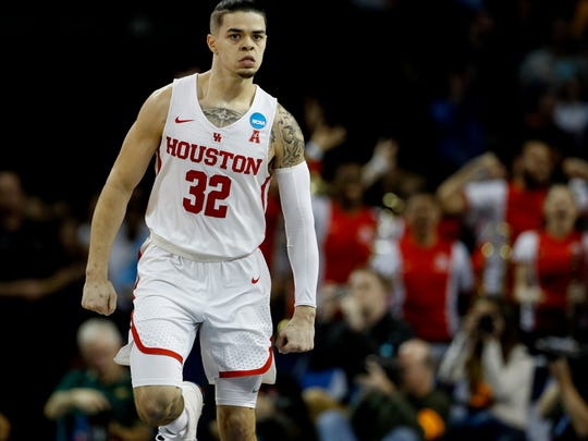 Houston guard Rob Gray (32) celebrates after making the game-winning basket in a NCAA men's college basketball tournament first-round game against San Diego State Thursday, March 15, 2018, in Wichita, Kan. Houston won 67-65. (AP Photo/Charlie Riedel)