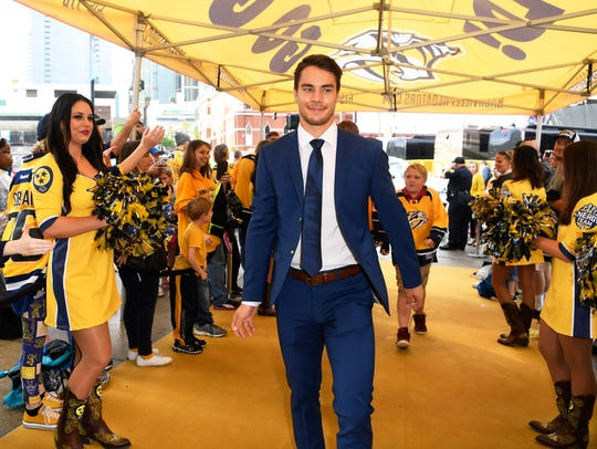 Juuse Saros walks the gold carpet during the Predators'