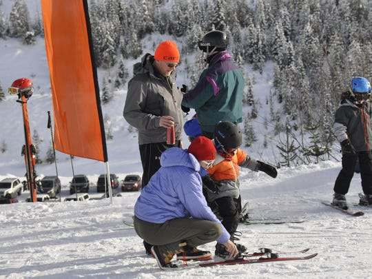 Volunteer instructors, parents and kids assemble for a Saturday session of the Free Ski School at Lookout Pass.
