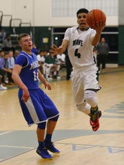 Anthony Vasquez of Long Branch drives to the basket