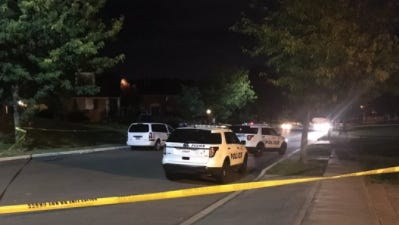 Police investigate in Mount Airy on Tuesday night after two people were shot.
