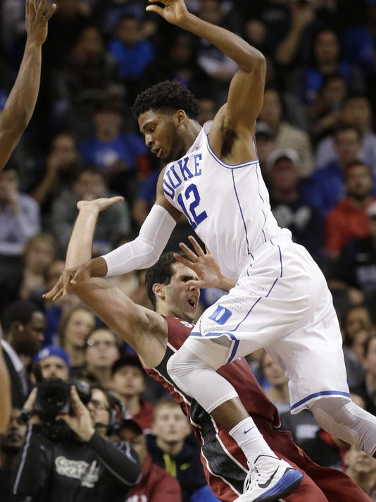Stanford's Stefan Nastic, bottom, fouls Duke's Justise Winslow during the first half of an NCAA college basketball game for first place in the Coaches vs. Cancer Classic, Saturday, Nov. 22, 2014, in New York. (AP Photo/Seth Weng)