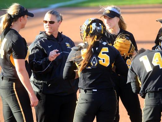 Iowa head coach Marla Looper talks to hear team during